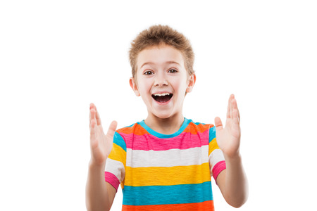 surprised child: Beauty smiling amazed or surprised child boy gesturing hand showing large size white isolated