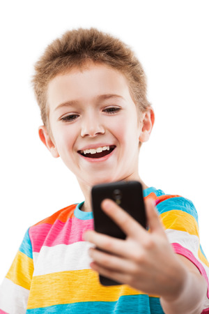 Little smiling child boy hand holding mobile phone or smartphone making selfie portrait photo white isolated photo