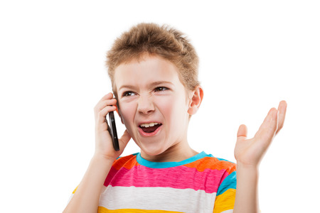 Amazed and surprised child boy hand holding mobile phone or talking smartphone white isolated photo