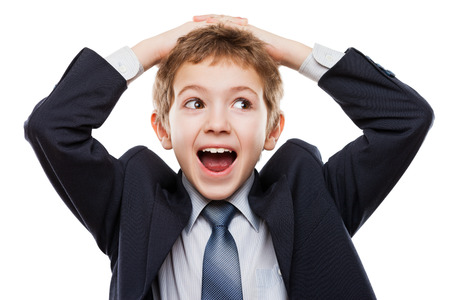 Amazed or surprised child boy in business suit hand holding hairs on head white isolated Stockfoto