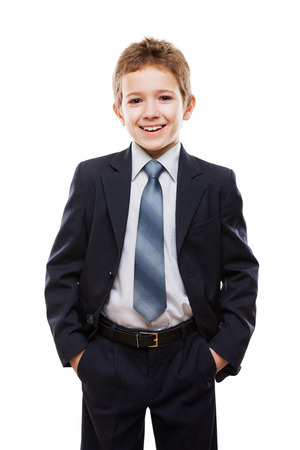 Handsome smiling child boy in business suit white isolated