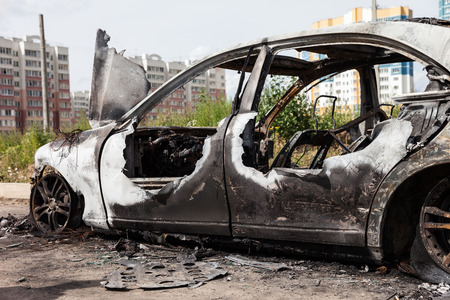 arson: Road wreck accident or arson fire burnt wheel car vehicle junk