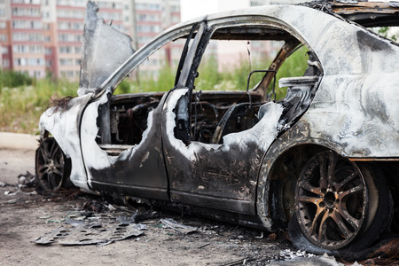 abandoned car: Road wreck accident or arson fire burnt wheel car vehicle junk