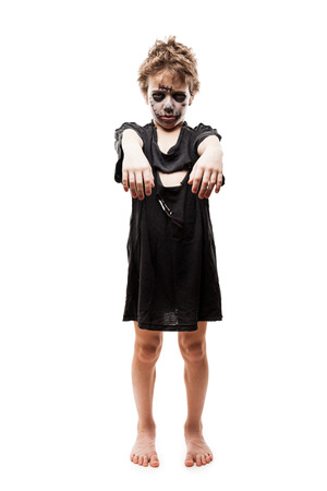 undead: Halloween or horror concept - screaming walking dead zombie child boy reaching hand white isolated