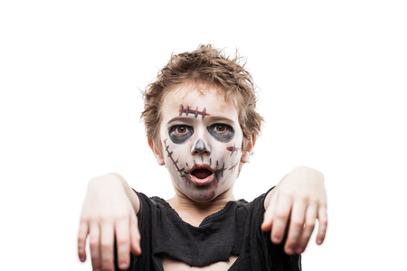 horror: Halloween or horror concept - screaming walking dead zombie child boy reaching hand white isolated
