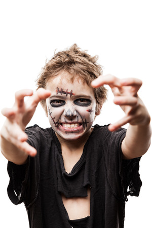 Halloween or horror concept - screaming walking dead zombie child boy reaching hand white isolated photo