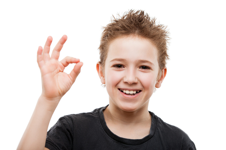 Beauty toothy smiling young teenager boy hand gesturing OK or success sign white isolated photo
