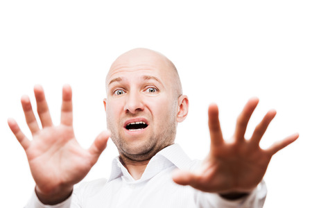 Scared or terrified businessman with fear and stress expression hand gesturing hide face stop sign white isolated Stock Photo