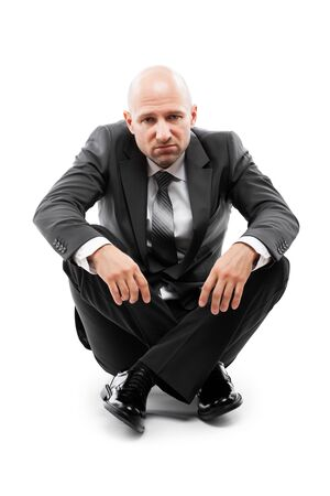 Business problems and failure at work concept - unhappy tired or stressed businessman in depression sitting floor white isolated