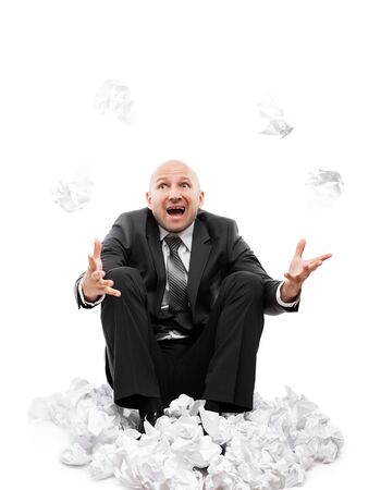 Business problems and failure at work concept - unhappy tired or stressed businessman in depression sitting down floor hand throwing crumpled torn paper document white isolated Stockfoto