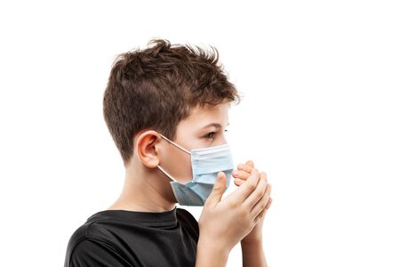 Human population virus, infection, flu disease prevention and industrial exhaust emissions protection concept - teenager boy wearing respiratory protective medical mask hands hiding face white isolated Stockfoto - 139993030
