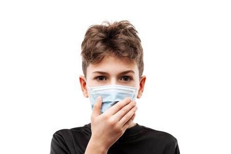 Human population virus, infection, flu disease prevention and industrial exhaust emissions protection concept - teenager boy wearing respiratory protective medical mask hand hiding face white isolated Stockfoto - 139993031
