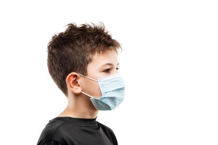 Human population virus, infection, flu disease prevention and industrial exhaust emissions protection concept - teenager boy wearing respiratory protective medical mask side view white isolated Stockfoto