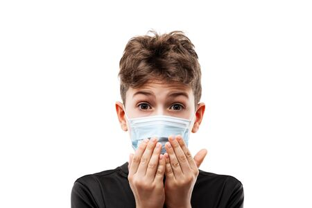 Human population virus, infection, flu disease prevention and industrial exhaust emissions protection concept - teenager boy wearing respiratory protective medical mask hands hiding face white isolated