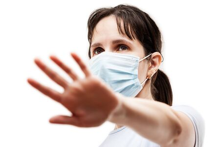 Human population virus, infection, flu disease prevention and industrial exhaust emissions protection concept - beauty woman wearing respiratory protective medical mask hand hiding face white isolated