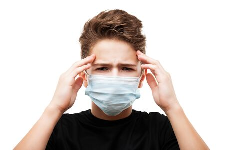 Human population virus, infection, flu disease prevention and industrial exhaust emissions protection concept - teenager boy wearing respiratory protective medical mask suffers headache white isolated Stockfoto