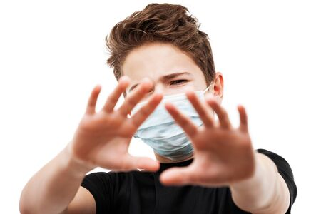 Human population virus, infection, flu disease prevention and industrial exhaust emissions protection concept - teenager boy wearing respiratory protective medical mask hand hiding face white isolated
