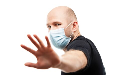 Human population virus, infection, flu disease prevention and industrial exhaust emissions protection concept - young adult bald head man wearing respiratory protective medical mask hand hiding face