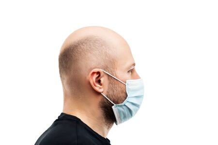 Human population virus, infection, flu disease prevention and industrial exhaust emissions protection concept - young adult bald head man wearing respiratory protective medical mask white isolated Stockfoto