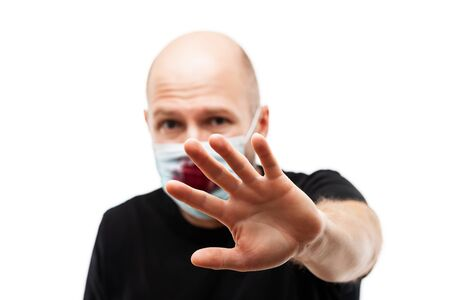 Human population virus, infection, flu disease prevention and industrial exhaust emissions protection concept - bald head man wearing bloody cough respiratory protective medical mask hand hiding face Stockfoto - 145203651