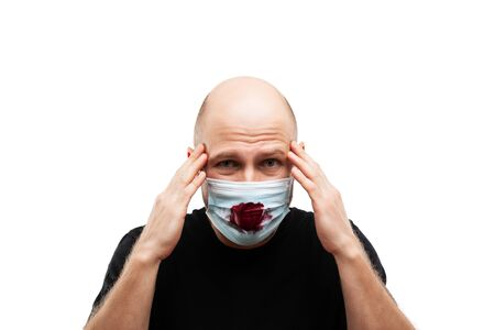 Human population virus, infection, flu disease prevention and industrial exhaust emissions protection concept - bald head man wearing bloody cough respiratory protective medical mask suffers headache