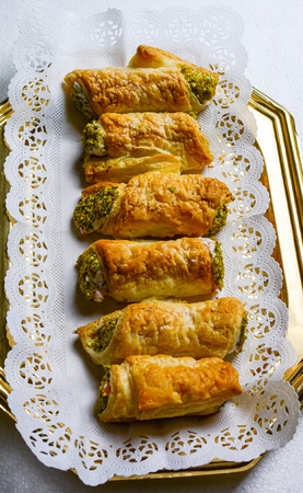 cannoli pastry: cannoli pastry stuffed with cheese and pistachios
