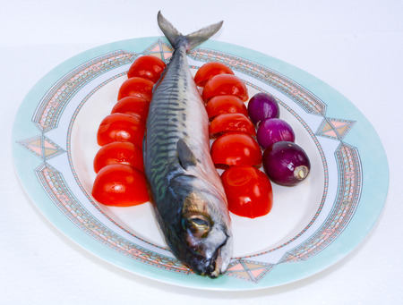 bluefish: italian bluefish mackerel cooked with cherry tomatoes and red onions Stock Photo