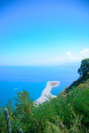 isthmus: rare view of isthmus of tindari beach in sicily