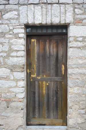 impenetrable: ancient wood door Abandon all hope ye who enter here
