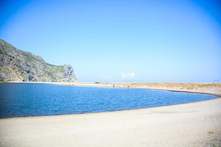rare view of tindari lake hidden cliff and beach in sicily Banco de Imagens