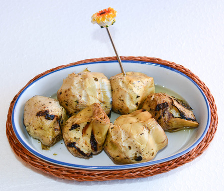 entrees: finger food apetizer with italian rosted artichokes Stock Photo