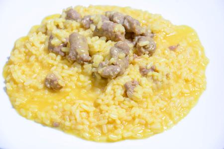 risotto with saffron sausage and chili pepper Stock Photo