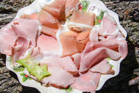 appetizer of Italian hams cooked raw and smoked Stock Photo