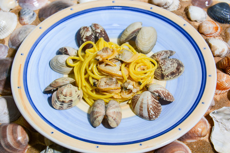 spaghetti with clams cooked separately and shelled separately and seasoned with spices