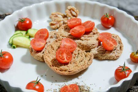 homemade Italian food: friselle with cherry tomatoes, extra virgin olive oil, salt and love