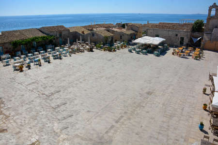 Sicily - Marzamemi: central square meeting place of nightlife and surrounded by typical Sicilian restaurants