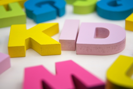 kid with toy letter Stock Photo