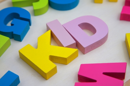 kid with letters wooden toy photo