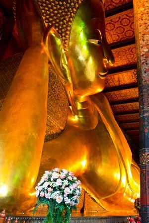 Lying Golden Buddha in Wat Pho of Bangkok photo