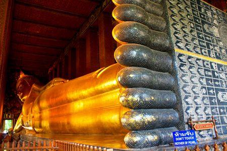 Lying Golden Buddha in Wat Pho of Bangkok Stock Photo - 7639859