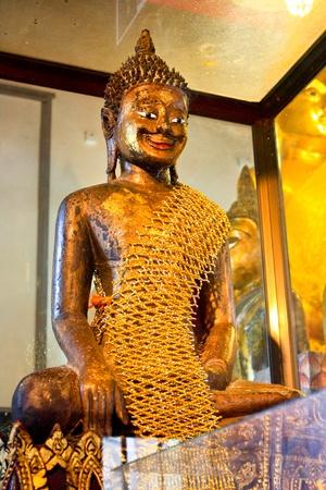 Smile Buddha in Temple of Ayutthaya, Thailand photo