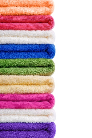 Set of colored towels on white