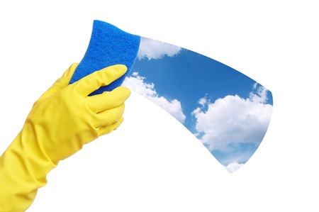 Hand in yellow glove cleaning the background with blue sponge