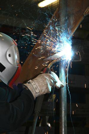 Worker welding steel photo