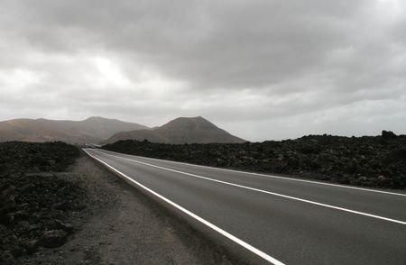 Highway in volcanic landscape
