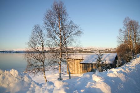 snow covered mountain: Winter lake with old shed