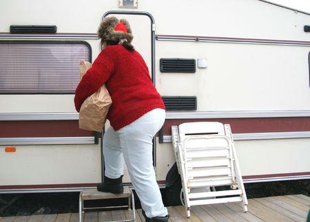 sweatsuit: Woman living in a trailer