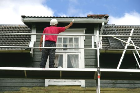 Man painting a house photo