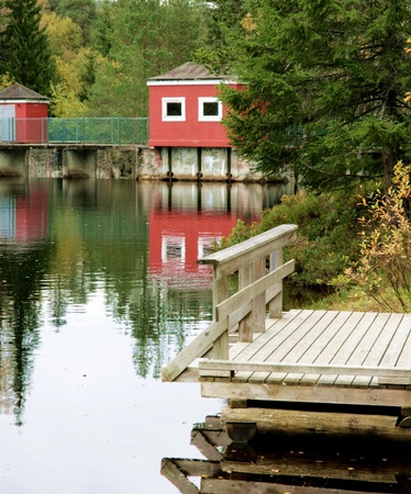 sluice: Dam with old sluice house