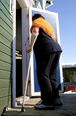 Disabled woman with crutch Stock Photo - 13171339